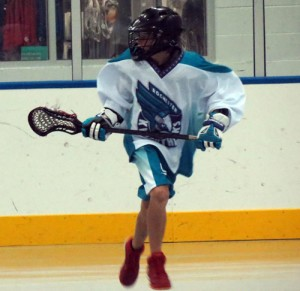 Riley Roe playing for the Rochester Knighthawks