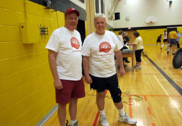 Rick Nicholls (right) playing volleyball at a fundraiser in Blenheim last December - Photo from Twitter